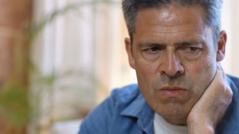 Close-Up-Shot-of-a-Middle-Aged-Man-Looking-Visibly-Concerned