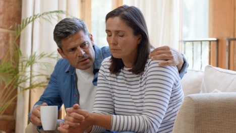 Wide-Shot-of-Man-Attempting-to-Comfort-Visibly-Concerned-Wife