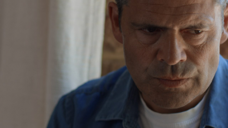 Close-Up-Shot-of-a-Middle-Aged-Man-Looking-Visibly-Worried