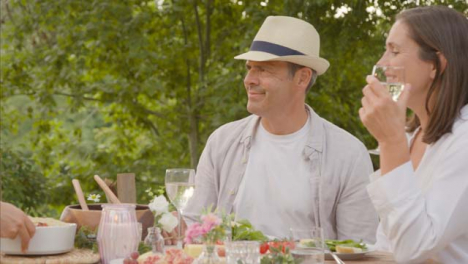 Wide-Shot-of-Middle-Aged-Couple-Thanking-Off-Screen-Waitress-for-Bringing-Bread-to-Table