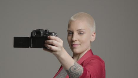 Female-model-vlogging-with-a-DSLR-