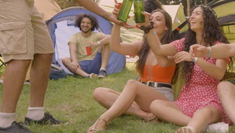 Sliding-Shot-of-Young-Festival-Goer-Bringing-His-Friends-Some-Drinks