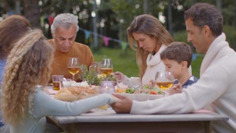 Medium-Shot-of-Family-Saying-Grace-Before-Dinner-