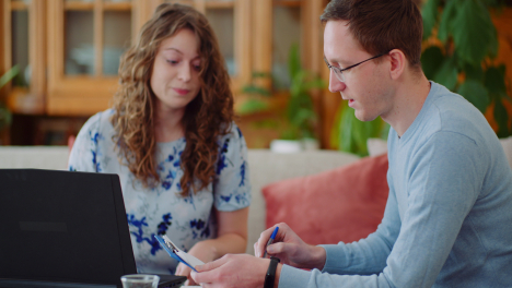 Man-And-Woman-Calculating-Bills-For-House-Costs