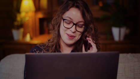 Portrait-Of-Businesswoman-Working-On-Laptop-While-Talking-On-Mobile-Phone-5