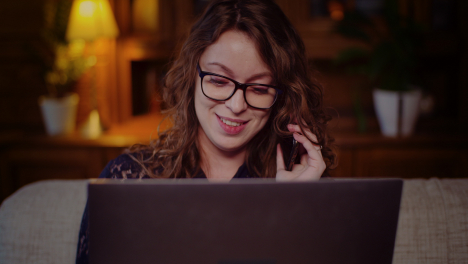 Portrait-Of-Businesswoman-Working-On-Laptop-While-Talking-On-Mobile-Phone-6