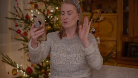 Positive-Woman-Video-Chatting-Christmas-Smartphone