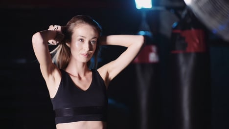Slow-Motion-Of-Confident-Young-Woman-Tossing-Hair-In-Gym