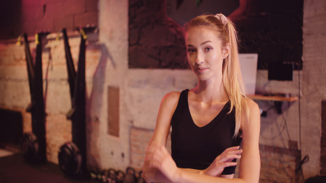 Lockdown-Shot-Of-Beautiful-Confident-Young-Woman-Standing-At-Fitness-Club