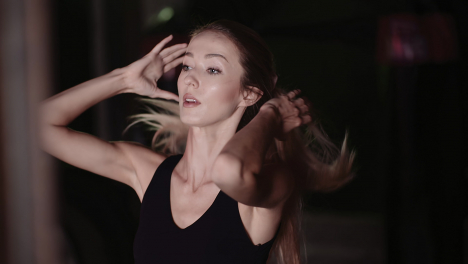 Slow-Motion-Of-Attractive-Female-Athlete-Tying-Hair-Before-Workout-At-Gym