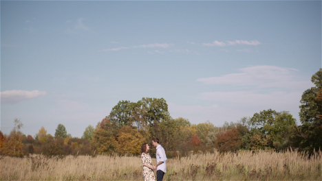 Couple-Hugging-And-Walking-On-A-Meadow-In-Summer-At-Sunset-19