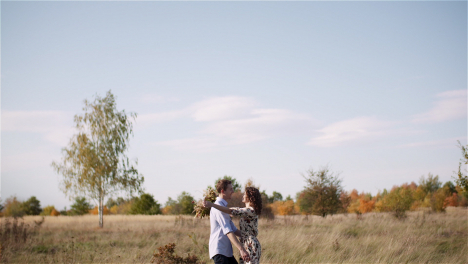 Couple-Hugging-And-Walking-On-A-Meadow-In-Summer-At-Sunset-42