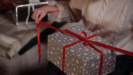 Positive-Happy-Woman-Unpacking-Gift-At-Christmas-3