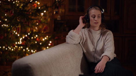 Attractive-Young-Woman-Listening-To-Music-On-Headphones-And-Sings-Songs-7