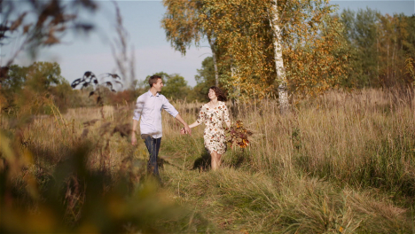 Couple-In-Love-Walking-And-Holding-Hands-Close-Up-9