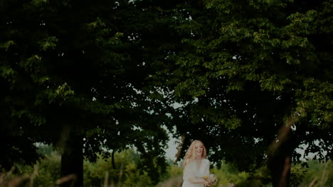 Young-Carefree-Woman-Tosses-Bouquet-Up-1