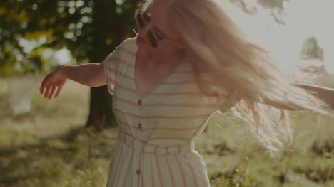 Happy-Attractive-Joyful-Woman-Hippie-Dancing-And-Walking-In-The-Sun-2