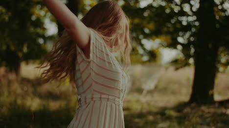 Happy-Attractive-Joyful-Woman-Hippie-Dancing-And-Walking-In-The-Sun-3