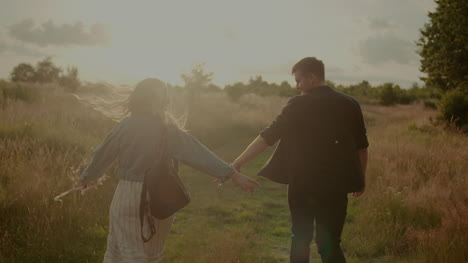 Young-Successful-Hipsters-Walking-And-Smiling-In-Summer-At-Sunset-6