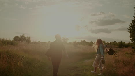 Attractive-Carefree-Young-Couple-Walking-And-Smiling-On-Holiday-2