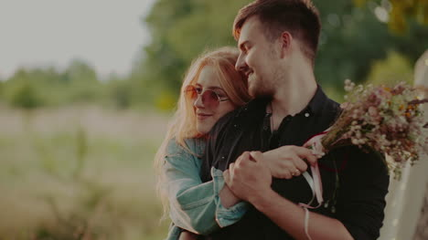 Positive-Woman-Supporting-Young-Man-Outdoors-At-Sunset-6