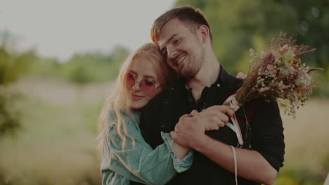 Engaged-Attractive-Couple-Hug-Against-Camp-2