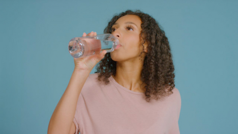 Portrait-Shot-of-Young-Adult-Woman-Drinking-from-Water-Bottle-02