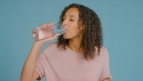 Portrait-Shot-of-Young-Adult-Woman-Drinking-from-Water-Bottle-03