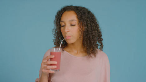 Portrait-Shot-of-Young-Adult-Woman-Drinking-Smoothie-01