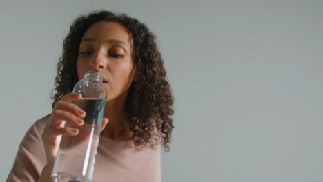 Close-Up-Shot-of-Young-Adult-Woman-Drinking-from-Water-Bottle-03