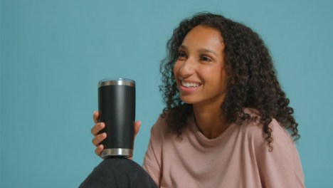 Medium-Shot-of-Young-Adult-Woman-with-Flask-Having-Conversation-02