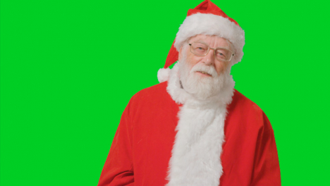 Portrait-Shot-of-Santa-Looking-to-Camera-with-Green-Screen