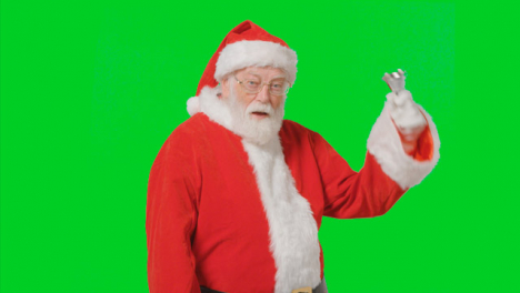 Portrait-Shot-of-Santa-Ringing-a-Bell-In-Front-of-Green-Screen
