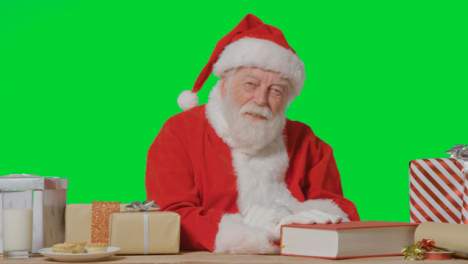 Portrait-Shot-of-Santa-Talking-to-Camera-In-Front-of-Green-Screen-