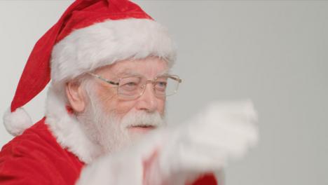 Close-Up-Shot-of-Santa-Waving-and-Looking-Off-Camera
