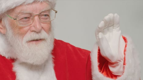 Close-Up-Shot-of-Santa-Claus-Waving-and-Looking-Off-Camera