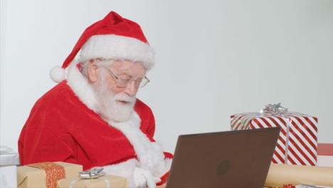 Medium-Shot-of-Santa-Talking-On-Laptop-Video-Call