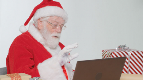 Medium-Shot-of-Santa-Talking-On-a-Laptop-Video-Call