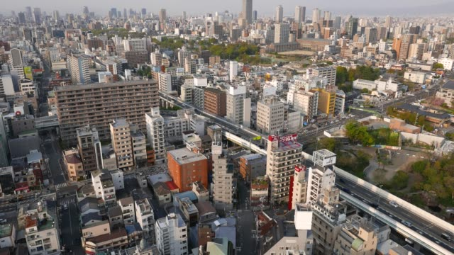 Car-traffic-aerial-view-of-Osaca-City-High-rise-buildings-and-road-top-view-
