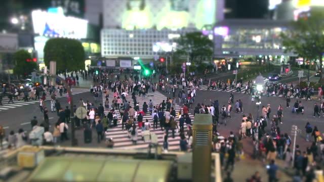 Slow-motion-people-at-Shibuya-Crossing-at-night-Tokyo-Japan