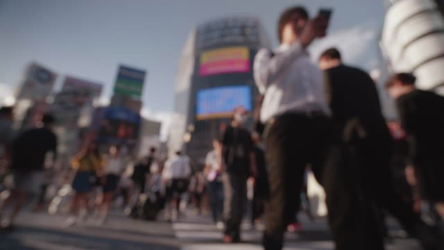 Soft-Focus---People-walking-at-the-scramble-intersection-(Summer-in-shibuya)