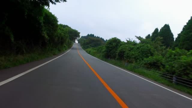 Driving-a-empty-country-road-to-Volcano-Aso-mountain-in-Kumamoto-prefecture-Japan