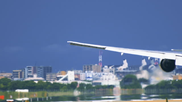 Airplane-touchdown-on-airport-runway-from-behind-in-extremely-closeup