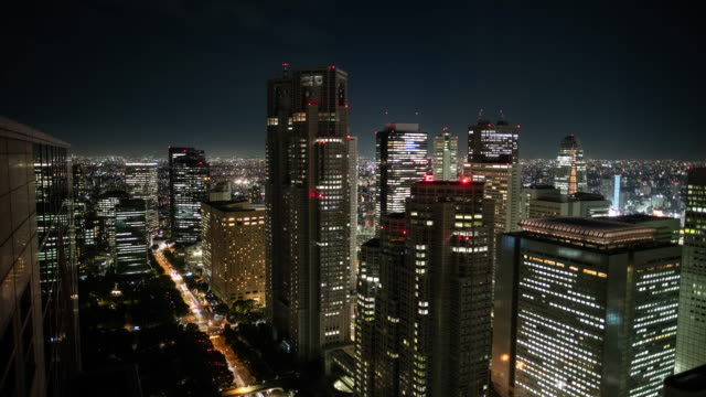 Time-Lapse-Shot-of-the-Cityscape-Big-City-with-Skyscrapers-Busy-Traffic-and-Night-Lights-Skyline