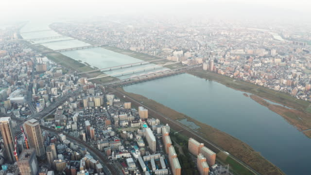 Aerial-view-over-Osaka-city-with-many-skyscrapers-in-the-morning-Osaka-is-the-capital-city-of-Osaka-Prefecture-the-second-largest-metropolitan-area-in-Japan-