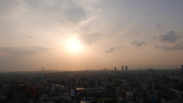Beautiful-sunset-downtown-panorama-setting-sun-over-Osaka-city-Japan