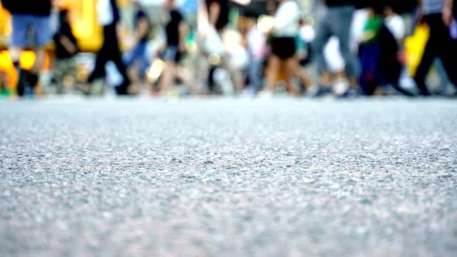 Legs-of-people-walking-on-the-crosswalk-in-Shibuya-Tokyo-in-Japan-4K