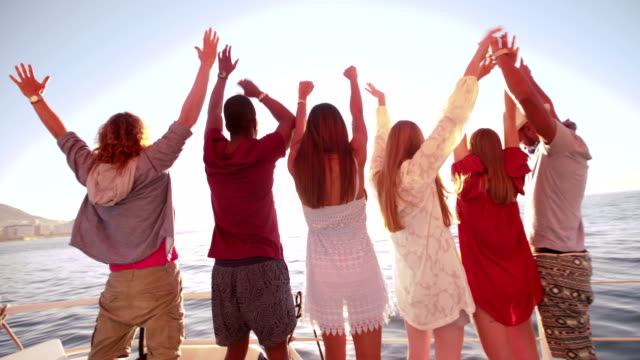 Multi-ethnic-group-of-friends-looking-at-horizon-from-a-yacht