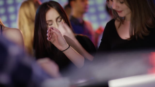 dark-haired-girl-dancing-at-club
