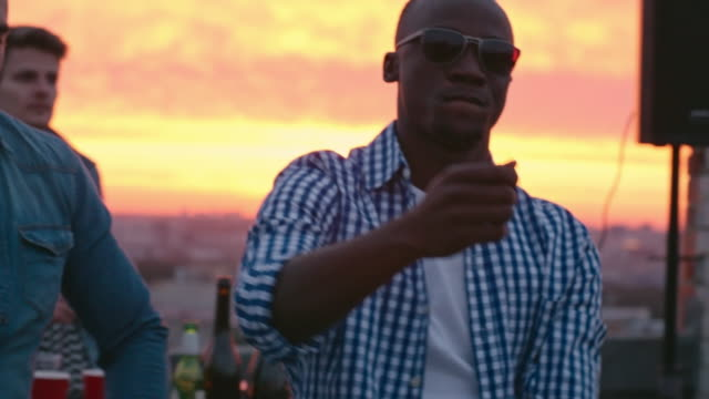Cool-African-American-Guy-Dancing-at-Sunset-Party